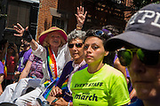 Grand Marshall Edie Windsor, wearing the sash, waves to the crowd near the Stonewall Inn, site of the Stonewall Riots in 1969.