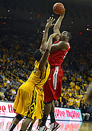 January 27, 2010: Ohio State forward Dallas Lauderdale (52) puts up a shot over Iowa forward Jarryd Cole (50) during the first half of their game at Carver-Hawkeye Arena in Iowa City, Iowa on January 27, 2010. Ohio State defeated Iowa 65-57.