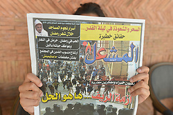 June 27, 2017 - Rabat, Morocco - A person reads 'Al Michaal' - an Arabic-speaking Moroccan daily, reporting on yesterday's violent demonstrations and riots that took place in Al Hoceima..The situation in the northern Morrocan city of Al-Hoceima remains tense since Sunday following the arrest of at least 20 protesters over the weekend by security forces. .On Tuesday, June 27, 2017, in Rabat, Morocco. (Credit Image: © Artur Widak/NurPhoto via ZUMA Press)