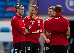 CARDIFF, WALES - Saturday, June 5, 2021: Wales' captain Gareth Bale (L) and Chris Gunter on the pitch before an International Friendly between Wales and Albania at the Cardiff City Stadium in their game before the UEFA Euro 2020 tournament. (Pic by David Rawcliffe/Propaganda)