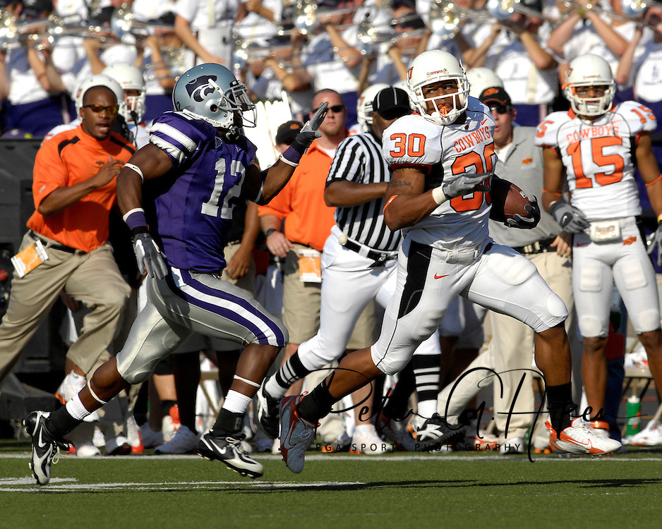 Oklahoma State kickoff returner Grant Jones (30) races past Kansas State's Devin Anderson (12) during his 89-yard return in the third quarter at Bill Snyder Family Stadium in Manhattan, Kansas, October 7, 2006.  The Wildcats beat the Cowboys 31-27.<br />
