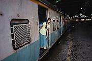 A young woman waiting for her train to depart from Mumbai's Chhatrapati Shivaji Terminus, Chhatrapati Shivaji Terminus (CST), Mumbai, India