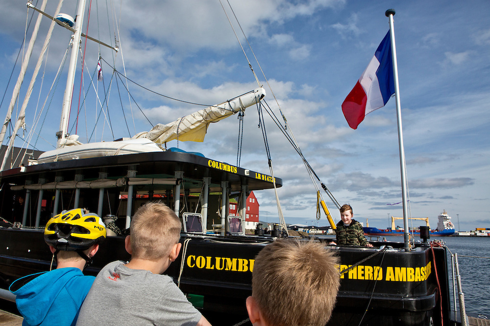Torshavn, Streymoy Island, Faroe Islands <br /> <br /> Young Faroese boys challenge each other to board Sea Shepherd's sailboat, the Colombus.  The Colombus was the site of the press conference to announce Sea Shepherd's presence in the Faroes over the summer.  The sailboat is owned by a French sailor and is open to the public.  The boat will remain in the islands throughout the summer as backup to the rest of the sea operations.