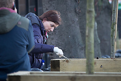 © Licensed to London News Pictures . 29/12/2013 . Manchester , UK . A woman searches through soil in a planter in a car park on Oxford Road in Manchester City Centre . The search for 17 year old Adam Pickup from Stockport , who was last seen in the early hours of Saturday 28th December in Manchester City Centre following a night out with friends as , this evening (Sunday 29th December 2013), Greater Manchester Police say they have arrested two men in connection with the teenager's disappearance . Photo credit : Joel Goodman/LNP