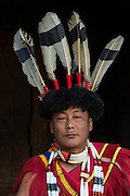 Ao Naga in festival dress with giant hornbill feathers<br /> Ao Naga headhunting tribe<br /> Nagaland,  ne India
