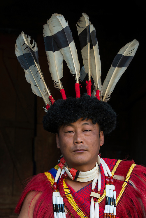 Ao Naga in festival dress with giant hornbill feathers<br /> Ao Naga headhunting tribe<br /> Nagaland,  ne India