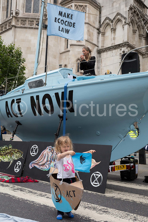 Environmental and climate change protesters block Fleet Street on the first day of a week-long country-wide protests using using five boats to stop traffic in Cardiff, Glasgow, Bristol, Leeds, and London, on 15th July 2019, in London, England. The group is calling on the government to declare a climate emergency, saying it was beginning a five-day summer uprising and that Ecocide ought to be a criminal offence in law.