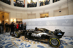 Kevin Magnussen and Romain Grosjean survey the new livery during the Rich Energy Haas F1 Team 2019 car launch at the Royal Automobile Club, London.