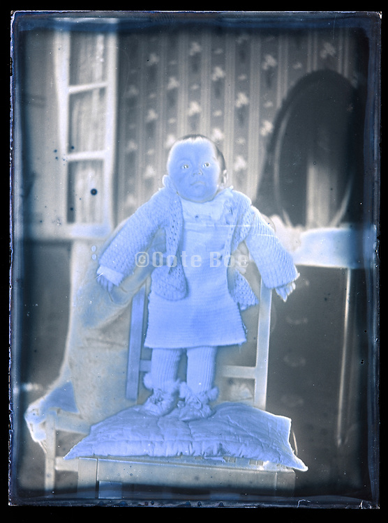 severely deteriorating glass plate with mother holding toddler standing France ca 1920s
