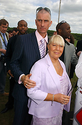 RUSSELL BUSHELL and actor LAILA MORSE at the Kuoni World Class Polo Day at Hurtwood Park Polo Club, Surrey on 28th May 2006.<br /><br />NON EXCLUSIVE - WORLD RIGHTS