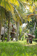 Wooden huts and locals in Togum Village, Lake Murray, Middle Fly District, Western Province, Papua New Guinea