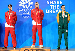 England's James Wilby (silver), Adam Peaty (gold) and South Africa's Cameron van der Burgh (bronze) with their medals after the Men's 100m Breaststroke Final at the Gold Coast Aquatic Centre during day three of the 2018 Commonwealth Games in the Gold Coast, Australia.