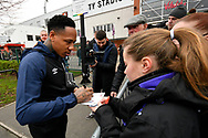 Nathaniel Clyne who on loan from Liverpool, signs his autograph for a young fan on arrival at the Vitality Stadium before the The FA Cup 3rd round match between Bournemouth and Brighton and Hove Albion at the Vitality Stadium, Bournemouth, England on 5 January 2019.
