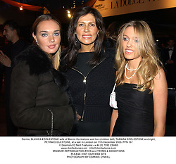 Centre, SLAVICA ECCLESTONE wife of Bernie Ecclestone and her children Left, TAMARA ECCLESTONE and right, PETRA ECCLESTONE, at a ball in London on 11th December 2003.PPN 157