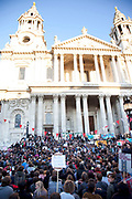 "Occupy London protest at St Pauls, October 15th 2011. Protest spreads from the US with this demonstrations in London and other cities worldwide. The 'Occupy' movement is spreading via social media. After four weeks of focus on the Wall Street protest, the campaign against the global banking industry started in the UK this weekend, with the biggest event aiming to ""occupy"" the London Stock Exchange. The protests have been organised on social media pages that between them have picked up more than 15,000 followers. Campaigners gathered outside  at midday before marching the short distance to Paternoster Square, home of the Stock Exchange and other banks.It is one of a series of events planned around the UK as part of a global day of action, with 800-plus protests promised so far worldwide.Paternoster Square is a private development, giving police more powers to not allow protesters or activists inside."