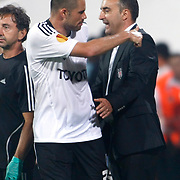 Besiktas's coach Carlos CARVALHAL (R) and Eduardo Goncalves De OLIVEIRA (L) during their UEFA Europa League Group Stage Group E soccer match Besiktas between Maccabi Tel Aviv at Inonu stadium in Istanbul Turkey on Thursday September 15, 2011. Photo by TURKPIX