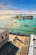 Arial view form St Mark's Campinale of St Mark's Square and the Doges with the island of San Giorgio Maggiore behind , with its church front designed by Andrea Palladio and begun in 1566.  Venice Italy