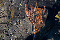 Bright red iron ore deposits on the gully walls of the river Markarfljót