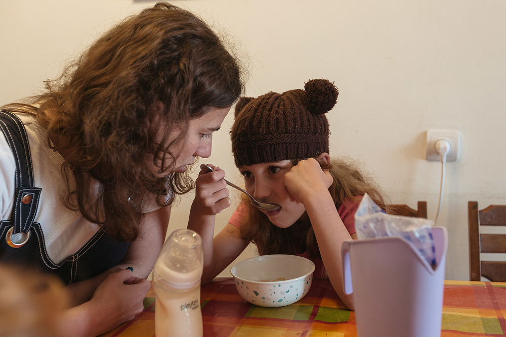 Clil and her mother Anna Michel, are seen during breakfast, at their home in Jerusalem, Israel, on May 3, 2020.