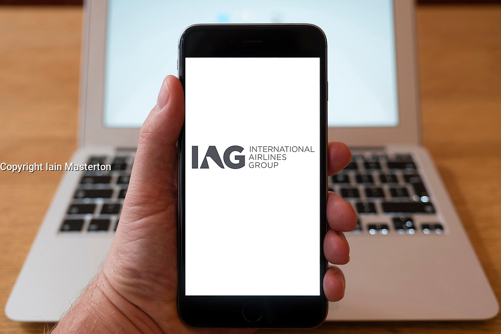 Using iPhone smartphone to display logo of IAG, International Airlines Group
