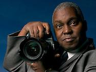 3/21/04  Omaha, NE Omaha World-Herald photojournalist Rudy Smith. (photo by Chris Machian/for Prarie Pixel Group)