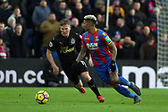 Patrick van Aanholt of Crystal Palace (R) in action with Matt Ritchie of Newcastle United (L). Premier League match, Crystal Palace v Newcastle Uutd at Selhurst Park in London on Sunday 4th February 2018. pic by Steffan Bowen, Andrew Orchard sports photography.