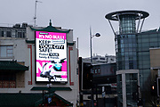 National coronavirus lockdown three begins in Birmingham city centre, which is deserted beneath a public health advice advertising campaign featuring Bully the Bull Ring bull wearing a face mask with the slogan Its NO bull. Keep your city safe on 6th January 2021 in Birmingham, United Kingdom. Following the recent surge in cases including the new variant of Covid-19, this nationwide lockdown, which is an effective Tier Five, came into operation today, with all citizens to follow the message to stay at home, protect the NHS and save lives.