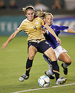 25 August 2007: US forward Heather O'Reilly (9) prepares to strike a second half goal in front of Finland's Susanna Lehtinen (14). The United States Women's National Team defeated the Women's National Team of Finland 4-0 at the Home Depot Center in Carson, California in an International Friendly soccer match.