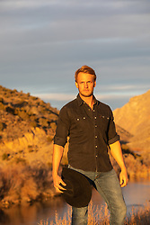 blond cowboy outdoors at sunset