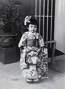 three years old girl made up for her , Shichi-go-san celebration Japan 1950s
