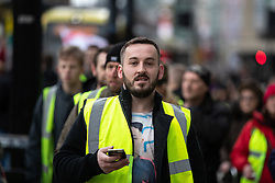 "© Licensed to London News Pictures . 09/02/2019. Manchester , UK . JAMES GODDARD leads a "" Yellow Vest "" protest in Manchester City Centre . The yellow vest concept has been adopted from French demonstrators by some British groups in support of Brexit , Donald Trump and former EDL leader Stephen Yaxley-Lennon - aka Tommy Robinson . A similar demonstration in the city in January was ridiculed after protesters were kettled by police in front of a branch of Greggs the Baker . Photo credit : Joel Goodman/LNP"