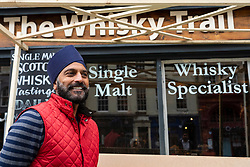 Edinburgh, Scotland, UK. 28 July, 2020. Business and tourism slowly returning to the shops and streets of Edinburgh city centre. Mr Bindi Landa ( one of the well known Gold Brothers) outside The Whisky Trail shop, in the process of renovation, on the Royal Mile, one of several tourist orientated shops he owns. His shops are being re-opened to cater for increasing numbers of tourists returning to the Old Town.  Iain Masterton/Alamy Live News