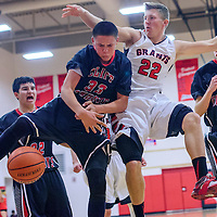 Grants Pirate Trey Narramore (22) and Cliff Cowboy Derek Runyan (32) compete for a rebound Friday at Grants High School.