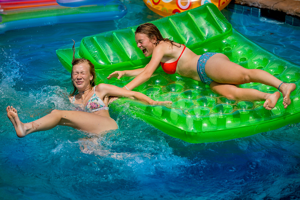 Elke Roemer and her cousin Izzy Kellner enjoy a little 4th of July pool party in Green Bay, Wisconsin.  Photo by Mike Roemer