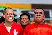 20 NOVEMBER 2013 - BANGKOK, THAILAND: NATTAWUT SAIKUA (left) and JATUPORN PROMPAN, core leaders of the Red Shirts and members of parliament in the Pheu Thai party, at a rally in Bangkok. Thousands of Red Shirts, supporters of the Pheu Thai ruling party in Thailand, gathered in Rajamangala Stadium in suburban Bangkok to listen to the Thai Constitutional Court deliver its verdict against the government. The court ruled that the recent efforts by the government to pass a blanket amnesty bill violated the Thai Constitution but the court did not order the party to disband or the dissolution of the government, which had been widely feared.     PHOTO BY JACK KURTZ