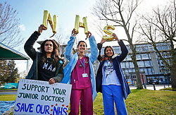 © Licensed to London News Pictures. 06/04/2016. London, UK. Junior doctors hold up inflatable NHS signs outside Northwick Park Hospital while protesting at a picket line as junior doctors in England start the forth 48-hours strike in a dispute over pay, working hours and patient safety on Wednesday, 6 April 2016. Photo credit: Tolga Akmen/LNP