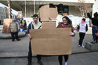 Occupy Dame Street protesters regroup at the Central Bank in Dublin Ireland after their encampment was dismantled by gardaí on 8th March 2012