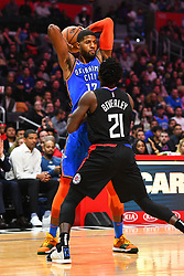 March 9, 2019 - Los Angeles, CA, U.S. - LOS ANGELES, CA - MARCH 08: Oklahoma City Thunder Forward Paul George (13) defended closely by Los Angeles Clippers Guard Patrick Beverley (21) during a NBA game between the Oklahoma City Thunder and the Los Angeles Clippers on March 8, 2019 at STAPLES Center in Los Angeles, CA. (Photo by Brian Rothmuller/Icon Sportswire) (Credit Image: © Brian Rothmuller/Icon SMI via ZUMA Press)