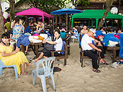 30 JULY 2013 - KOH SAMET, RAYONG, THAILAND:   Tourists at an outdoor restaurant on Ao Phia beach on Koh Samet island. This part of the island was not impacted by the oil spill that fouled the west side of the island. About 50,000 liters of crude oil poured out of a pipeline in the Gulf of Thailand over the weekend authorities said. The oil made landfall on the white sand beaches of Ao Prao, on Koh Samet, a popular tourists destination in Rayong province about 2.5 hours southeast of Bangkok. Workers from PTT Global, owner of the pipeline, and up to 500 Thai military personnel are cleaning up the beaches. Tourists staying near the spill, which fouled Ao Prao beach, were evacuated to hotels on the east side of the island, which was not impacted by the spill. PTT Global Chemical Pcl is part of state-controlled PTT Pcl, Thailand's biggest energy firm.    PHOTO BY JACK KURTZ