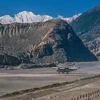 A Twin Otter plane prepares to take of from the airstrip at Jomsom, Nepal,