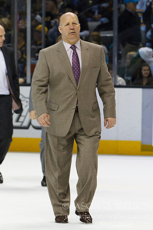 Mar 22, 2012; San Jose, CA, USA; Boston Bruins head coach Claude Julien walks across the ice to the locker room after the second period against the San Jose Sharks at HP Pavilion. Mandatory Credit: Jason O. Watson-US PRESSWIRE