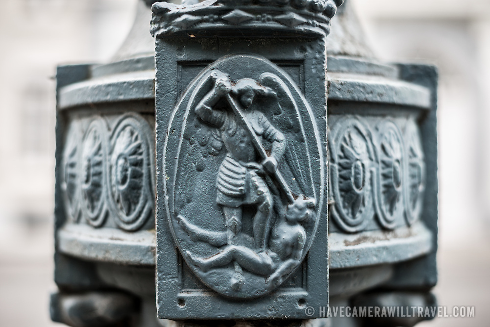 An artistic depiction of a Belgian legend on the base of a street lamp in the Royal Quarter of Brussels, Belgium.