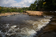 Richmond Falls on the River Swale. Richmond is a market town and the centre of the district of Richmondshire. Historically in the North Riding of Yorkshire, it is situated on the edge of the Yorkshire Dales National Park. North Yorkshire, England, UK.