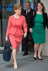 © Licensed to London News Pictures. FILE PICTURE: 14/07/2015. London, UK. Leader of the SNP and First Minister of Scotland, NICOLA STURGEON leaving BBC Broadcast House in London with her aide LIZ LLOYD (pictured right) after appearing on the Today programme on Radio 4. There are claims that Sturgeon's top political aide in government knew about the civil service probe into Alex Salmond months before the First Minister claims she found out. Photo credit: Ben Cawthra/LNP