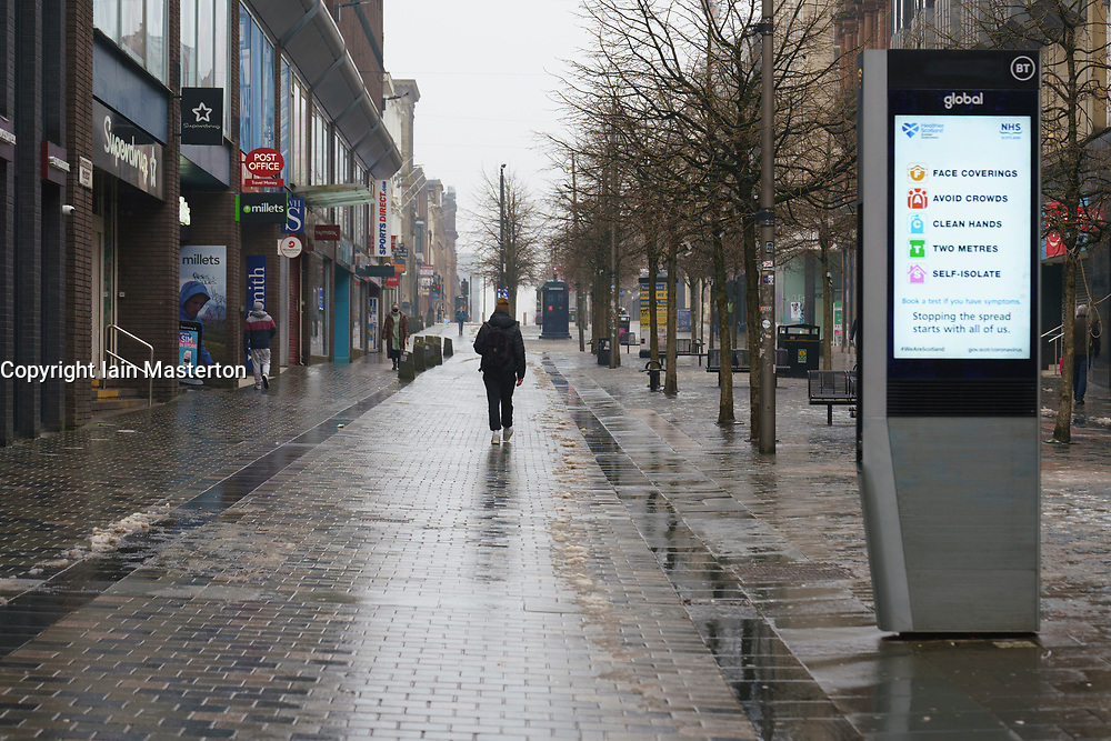 Glasgow, Scotland, UK. 7 January 2020. Scenes from morning in Glasgow city centre during the national Covid-19 lockdown. Normally busy streets are almost deserted because most shops and non essential businesses are closed.  Pic; Sauchiehall Street looks very desolate.  Iain Masterton/Alamy Live News