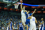 19 MAR 2015: Trey Lyles (41) of University of Kentucky dunks on Quinton Chievous (3) of Hampton during the 2015 NCAA Men's Basketball Tournament held at the KFC Yum! Center in Louisville, KY. Kentucky defeated Hampton 79-56. Brett Wilhelm/NCAA Photos