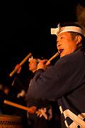 Close-up of man playing flute at traditional festival, Nozawaonsen, Japan