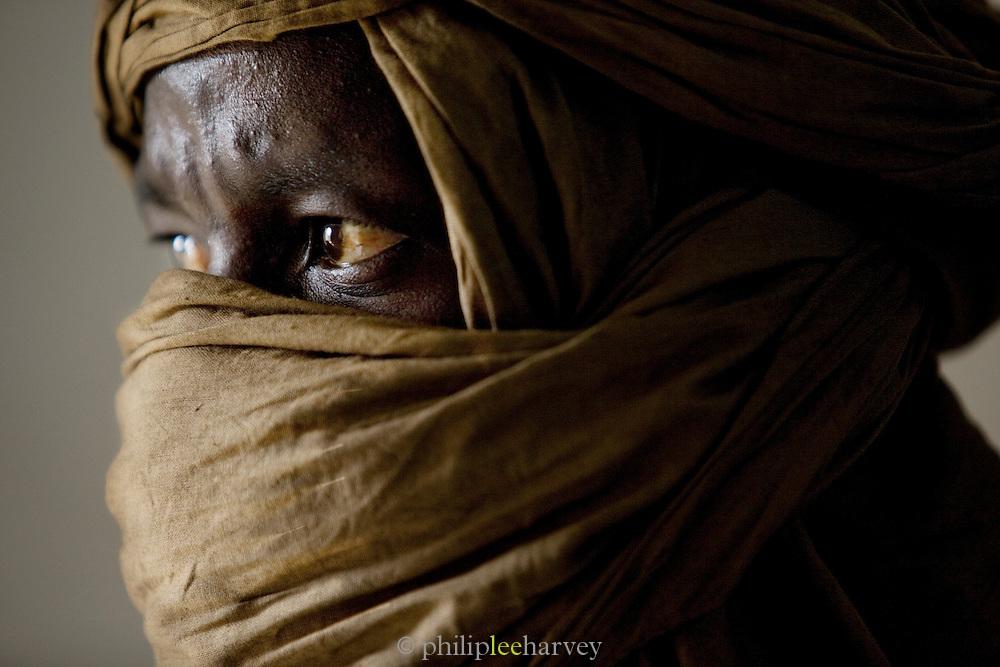 A tuareg man in headscarf in Djenné, Mali