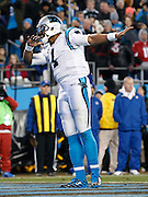 CHARLOTTE, NC - JAN 24:  Quarterback Cam Newton #1 of the Carolina Panthers dabs during the NFC Championship game against the Arizona Cardinals at Bank of America Stadium on January 24, 2016 in Charlotte, North Carolina.