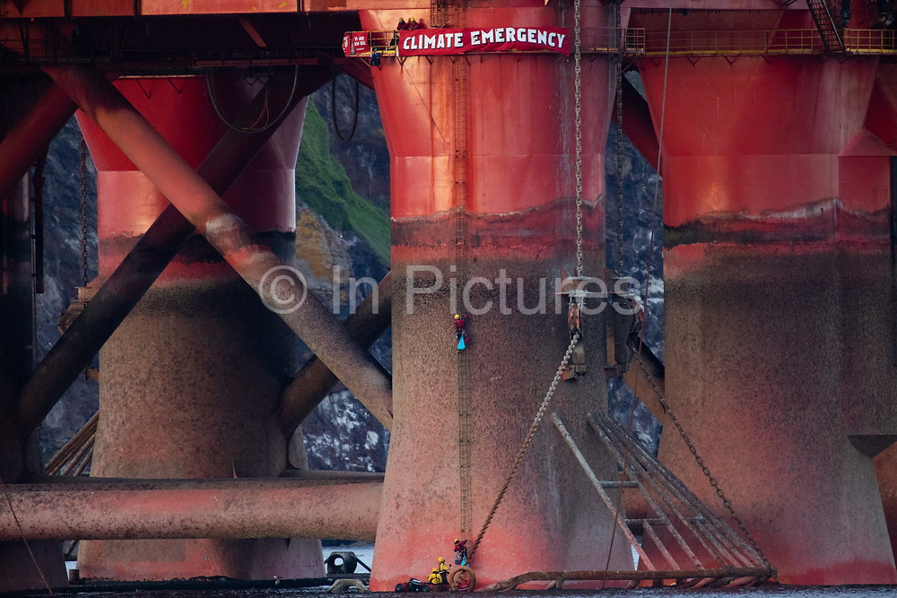 Greenpeace activists board a BP oil rig in Cromarty Firth to stop it from further oil drilling at sea, June 10th 2019, Cromarty, Scotland, United Kingdom. The oil rig Paul B. Loyd, Jnr, owned by Transocean, was due to head to BPs Vorlich field, 150 miles 241km east of Aberdeen to drill for oil for BP. Change-over of Greenpeace climber.The occupation by Greenpeace activists subsequently delayed the departure for 5 days and 14 activists were arrested in the process. Greenpeace says that in an age of climate emergency BP should not be drilling for new oil but look for non-fossil fuel means of energy.